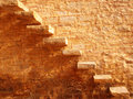 Stone stairs beside the golden color wall Stock Photo