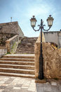 Stone stairs with lantern inside the old fort of corfu city in greece Stock Image