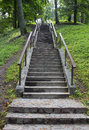 stone stairs up to hill with handrails at both sides Royalty Free Stock Photo