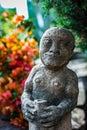 Stone Statue In A Garden