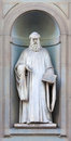 Stone statue of guido aretino depicting historical character Stock Images