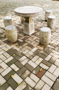 Stone table and stool on brick floor in summer Royalty Free Stock Photography