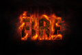 Stone text covered fire dark background Stock Photography