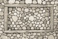 Stone texture with a wooden frame Royalty Free Stock Photo