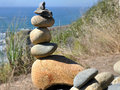 Stone tower one of a collection of balancing towers along the pacific coast highway ca Royalty Free Stock Images