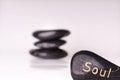 Stone treatment. Black massaging stones  on a white background. Hot stones. Balance. Zen like concepts. Basalt stones. Royalty Free Stock Photo