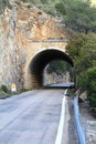 Stone tunnel at mountain road Royalty Free Stock Image