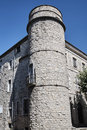 A stone turret and medieval buildings Royalty Free Stock Photo