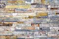 Stone veneer mineralized quartz rock ledge wall natural materials in classic building patterns and methods for sample texture and Stock Photos