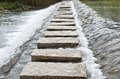 Stone walkway cross stream Royalty Free Stock Photos