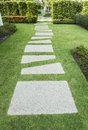 Stone walkway in the garden green Royalty Free Stock Images