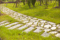 Stone walkway two cross in garden Royalty Free Stock Images