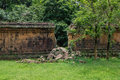 A stone wall of an ancient ruin with a big gap from a break through - angkor Royalty Free Stock Photo