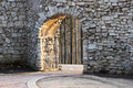Stone wall with an arch Royalty Free Stock Photo