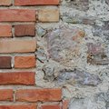 Stone wall background closeup, vertical plastered grunge red brick stonewall, beige limestone pattern, old aged weathered beige Royalty Free Stock Photo
