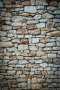 Stone wall background. Vignetted borders. Vertical photo Royalty Free Stock Photo