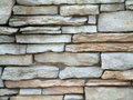 Stone wall background grey and amber colored cut Royalty Free Stock Photography