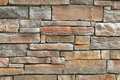 Stone wall background with stones of various sizes and shapes Royalty Free Stock Photo