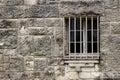 Stone wall and barred window of spanish mission espada in san antonio texas Royalty Free Stock Photo