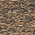 Stone wall, brown relief texture with shadow Royalty Free Stock Photo