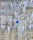 Beautiful Stone Wall with Mineral Deposits and Handicapped Parking Sign Background