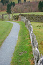 Stone wall fence and kissing gate. Royalty Free Stock Photo