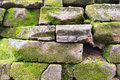 Stone wall with green moss. Royalty Free Stock Photo