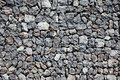 Stone wall grey lava boundary Stock Image