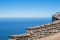 Stone wall high up on Table Mountain overlooking ocean Royalty Free Stock Photo