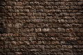 Stone wall made ​​of rough bricks dark Stock Photo