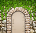Stone wall with medieval arch and leaves Royalty Free Stock Images