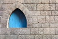 Stone wall middle ages spain window in the Stock Photos
