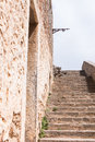 Stone wall with portal and stairway of a medieval fortress Royalty Free Stock Photo