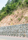 Stone wall - for protect rock fall down and erosion from hill. Royalty Free Stock Photo