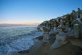 Stone wall by the sea, boulders Royalty Free Stock Photo