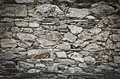 Stone wall in a village in northern spain Stock Photos