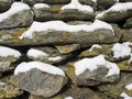Stone Wall with Winter Snow Royalty Free Stock Photo