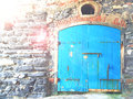 Stone wall with wooden door blue. Royalty Free Stock Photo