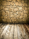 Stone wall and wooden floor Stock Images