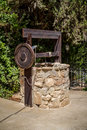 Stone water well with winch near the entrance to the archaeological park of Shiloh, Israel Royalty Free Stock Photo