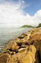 Stone wave barrier near seashore in chanthaburi thailand Royalty Free Stock Photo