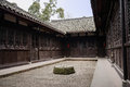 Stone well in yard of ancient Chinese mansion Stock Image