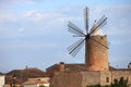 Stone windmill with six vanes historical for generating power and energy behind a wall Stock Photo