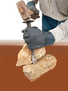 Stone work stoneworker with hammer chisels Royalty Free Stock Image