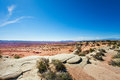 Stoned deserts view near canyonlands national park with bushes in usa during sunny summer day Royalty Free Stock Photography