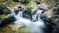 Stoned waterfall a narrow water flow between the stones in the forest raman phang nga province thailand Royalty Free Stock Photo