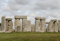 Stonehenge the ancient neolithic stone circle in wiltshire england grey sky adds atmosphere Stock Photography
