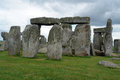 Stonehenge with clouds and green grass Royalty Free Stock Photos