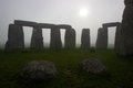 Stonehenge at dawn on a foggy day view of morning with the sun rising over the stones Royalty Free Stock Images