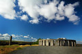 Stonehenge replica and clouds the with its pointer pillar sits under blue skies with fluffy white built by sam hill as a wwi Stock Photos